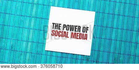 Blank Note Pad With The Power Of Social Media Text On Green Wooden Background
