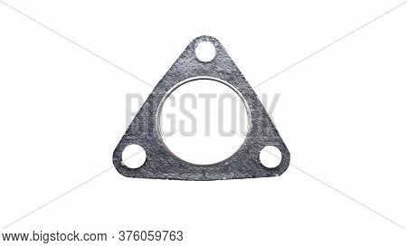 Automotive Gasket For The Exhaust System Isolated On White Background. Spare Parts.