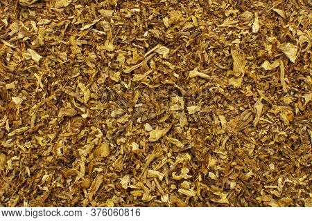 Tobacco Texture. High Quality Dry Cut Tobacco Big Leaf Close Up Background.