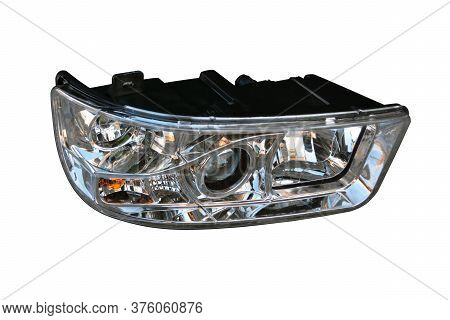 Car Front Headlight On An Isolated White Background. Spare Parts.