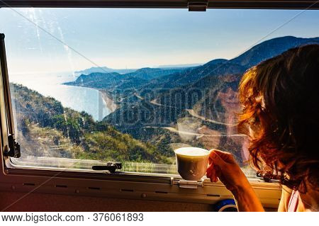 Tourist Woman In Camper Rv Drinking Coffee And Enjoy Coast View From Viewpoint Mirador De La Granati