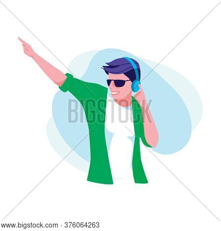 Teenage Boy Listening Music With Headphones. Smiling Guy Wearing Fashionable Clothes And Sunglasses