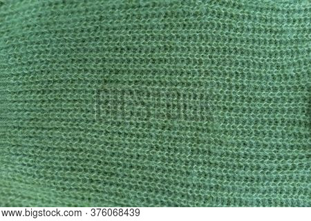 Horizontal Knitted Pattern Of Green Fluffy Woolen Cloth, Texture, Seasonal Clothes For Autumn And Wi