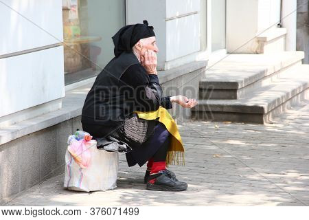 August, 2013: An Elderly Woman Asks For Money On A City Street, Tbilisi, Georgia. Social Documentary