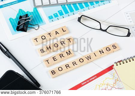 Total Short Term Borrowings Concept With Letters On Cubes. Still Life Of Office Workplace With Suppl