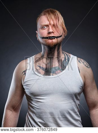 Picture Of A Tattooed Scary Mad With Horror Make-up