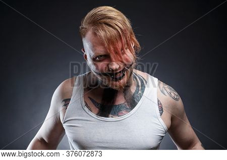 Image Of A Tattooed Scary Mad Man With Horror Make-up
