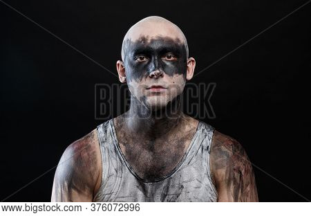 Photo Of Young Bald Mad Man With Dirty Make-up Effect