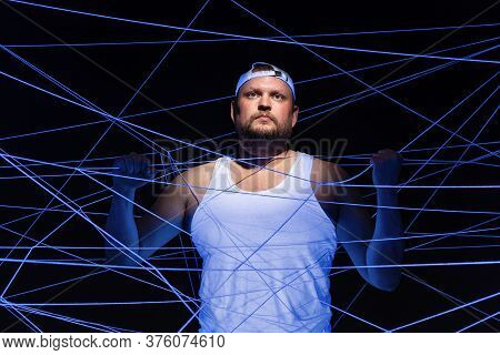 Image Of Fat Man Tangled In White Threads In Ultraviolet