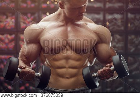 Fitness Man Pumping Up Arm Muscles