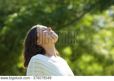 Relaxed Middle Age Woman Breathing Fresh Air Standing In The Park At Summer