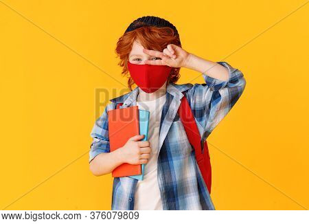 Boy In Casual Clothes And Mask Looking At Camera And Gesturing V Sign Near Eyes While Being Ready Fo