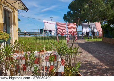 gondolier's washed clothes dry in the sun