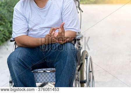 Patients Sitting On A Wheelchair His Hands Are Kinking Due To A Nervous System Illness And Paralysis