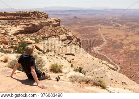 Youngster Enjoying The View Of The Deserts Of Monument Valley In Arizona Utah In Usa