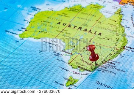 Push pin pointing to Canberra in Australia