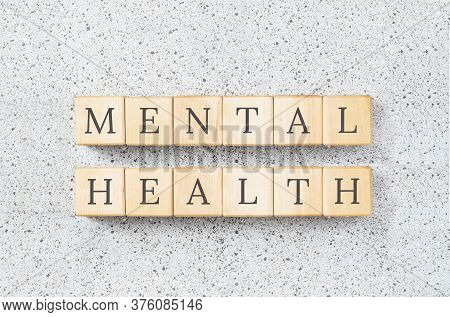 Mental Health Text On Wooden Building Blocks. Minimal Concept On Grey Cork Board Background. Raising