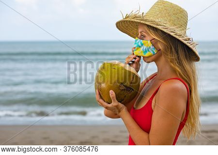 Funny Portrait Of Woman In Straw Hat Drinking Young Coconut On Tropical Sea Beach. New Rules To Wear