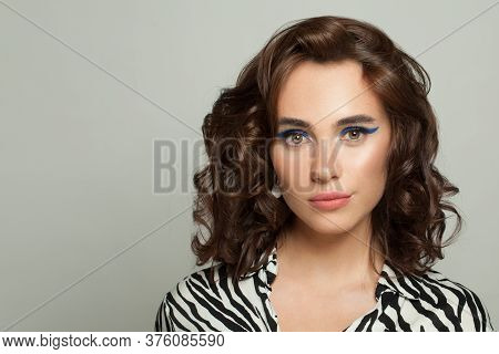 Fashion Portrait Of Beautiful Young Woman With Clear Skin And Dark Curly Hairstyle Portrait