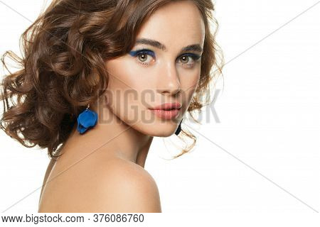 Beautiful Face. Perfect Woman With Clear Skin And Dark Curly Hair Isolated On White