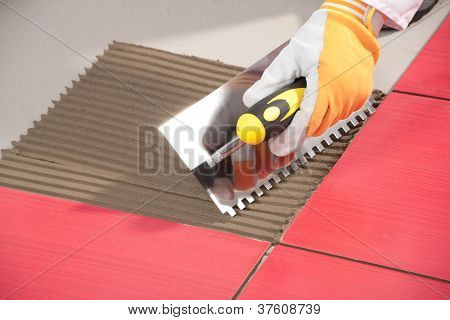Notched Trowel On Red Tiles