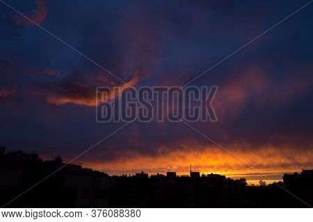 Pink Orange Purple Sunset Over The City. Multicolored Sky And Black Silhouette Of Tall Buildings Of