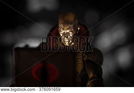 JULY 9 2020 - Scene with Cobra crime boss Destro from the GI Joe series looking into a briefcase with glowing light - Hasbro action figure
