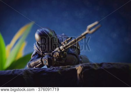 JULY 11 2020: Scene from Disney Plus The Mandalorian - the bounty hunter aiming his pulse rifle - Hasbro action figur