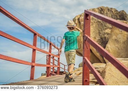 Little Boy On Boardwalk With Stairs To The Beach, Vacation Concept