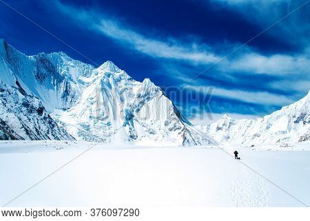 Snow Peaks Of Mountains With Blue Sky And Beautiful Clouds