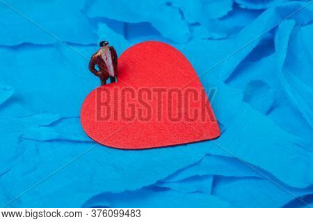 Red Heart Shaped On Blue Color For Love Card And Valentine Day Concept