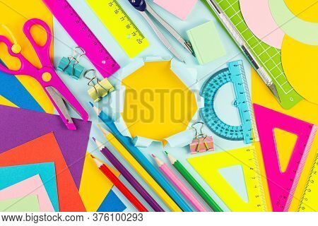 Back To School Card. Various Writing Tools And Other School Stationary On Colorful Paper Background.