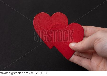 Red Hearts On Black Color For Love Card And Valentine Day Concept