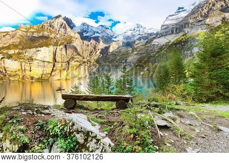 Bench And Turquoise Color Oeschinensee Lake And Swiss Alps Autumn Panorama, Berner Oberland, Switzer