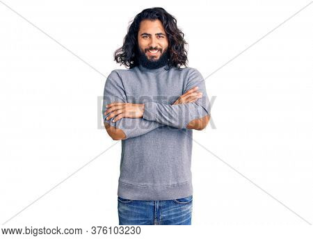 Young arab man wearing casual clothes happy face smiling with crossed arms looking at the camera. positive person.