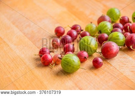Red Green Gooseberry On Wooden Background.berries, Bio, Gardening Concept.fresh Ripe Red And Green G