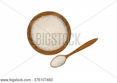 Top View Of Refined Granulated Sugar In Wooden Plate And In Wooden Spoon On White Background With Cl