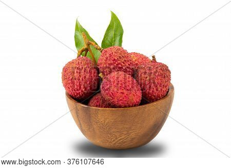 Lychees In A Wooden Bowl On White Background With Clipping Path.