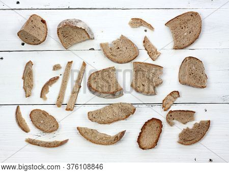 Dry Bread On White Table, Flat Lay.remains Of Dry Bread Good For Animals. Do Not Waste With Food.