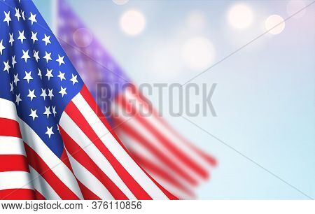 America Flag Waving Against A Clear Blue Sky. Design Concept For National American Holidays. Patriot