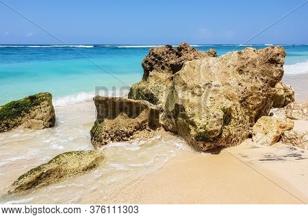 Day View On Indian Ocean, Stones And Rocks On Karma Beach With White Sand On Bali, Indonesia