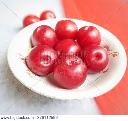 Colorful Red Plums Kept In Bowl Placed In Red And White Backgrounds And Reduce The Risk Of Cancer He