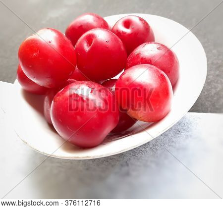 Colorful Red Plums Kept In Bowl Placed In Black And White Backgrounds And Reduce The Risk Of Cancer