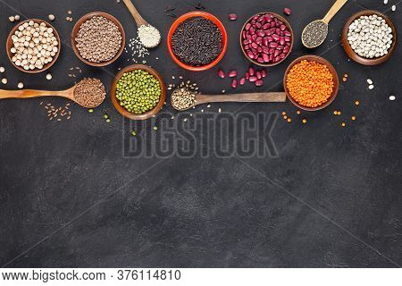 Legumes, Seeds And Cereals On A Dark Background. Healthy Food. Top View