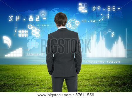 Businessman agaisnt virtual background