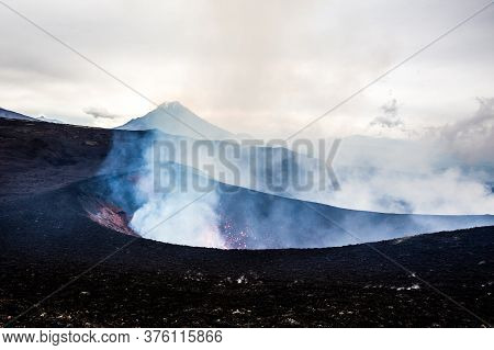Crater Of Erupting Volcano On The Overcast Weather, Volcanic Landscape