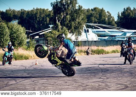 Moscow, Russia - 12 Jul 2020: Moto Rider Making A Stunt On His Motorbike. Stunt Motorcycle Rider Per