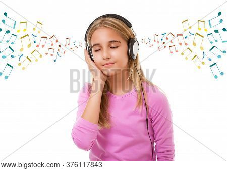 Technology, And Music Concept- Teenage Lovely Girl With Headphones Listening Music With Closed Eyes
