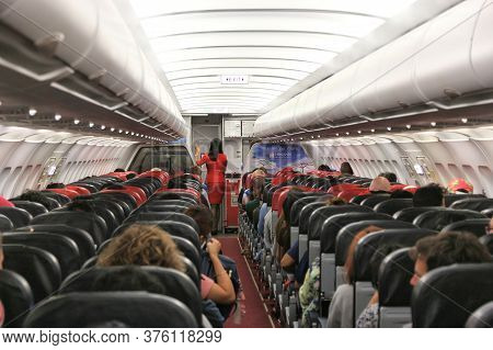 Manila, Philippines - December 6, 2017: Passengers Fly Onboard Low Cost Airline Air Asia Airbus A320