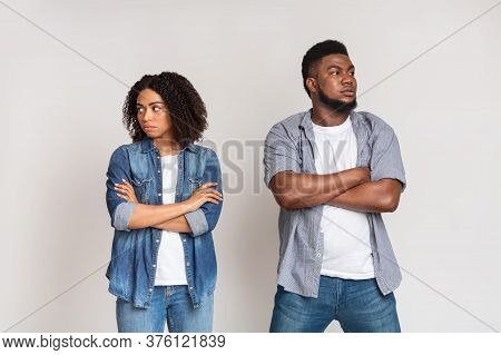 Relationship Problems. Offended African American Couple Ignoring Each Other After Argue, Standing Wi